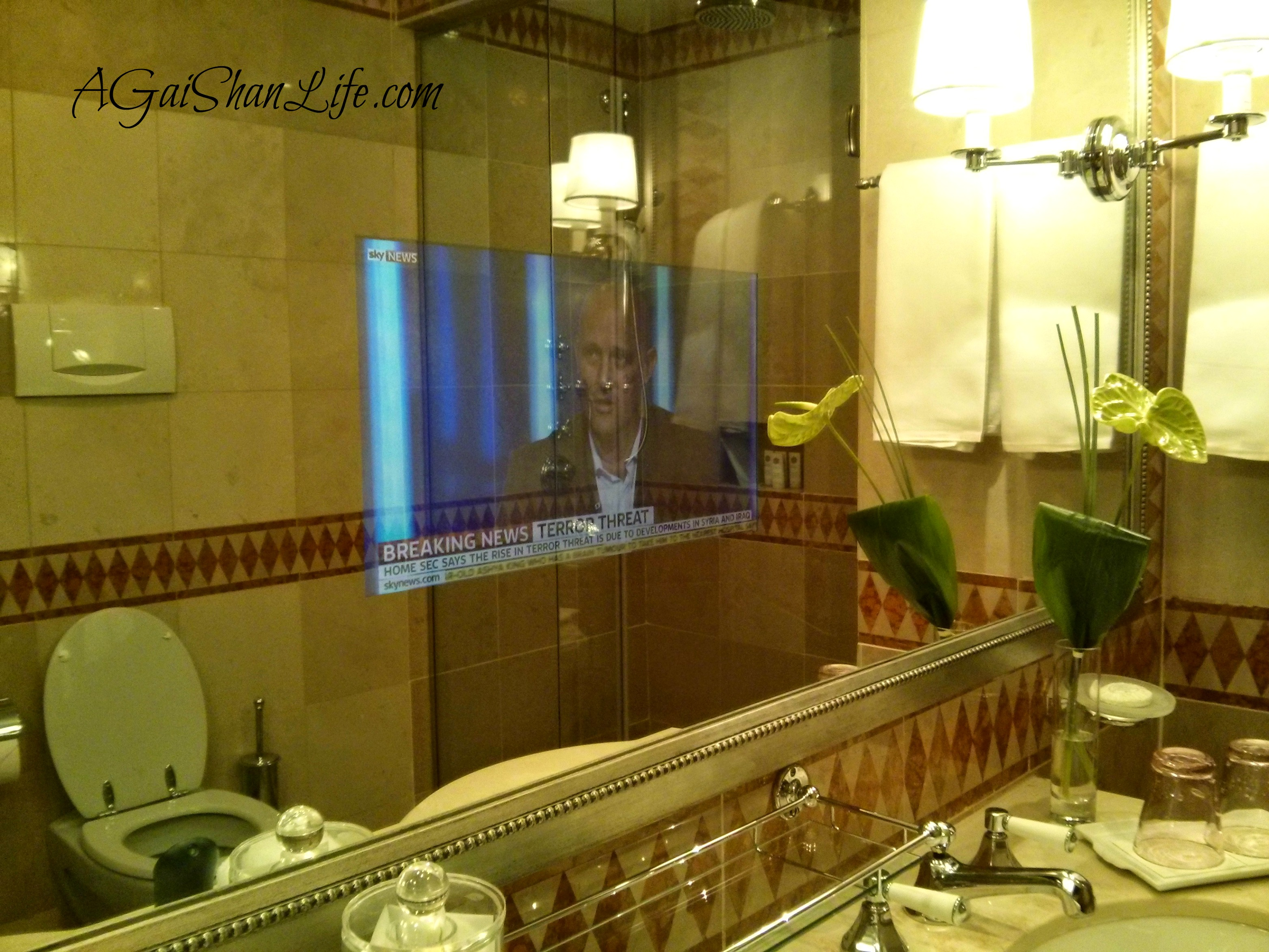 The fanciest hotel yet: a built in TV. In the bathroom mirror.